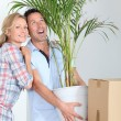 Couple carrying plant — Stock Photo #8335911