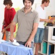 Three men doing housework — Stock Photo