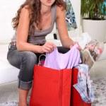 A brunette going through her shopping. — Stock Photo #8337256