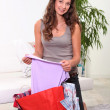 Woman looking at her fashion purchases — Stock Photo #8337267