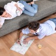 A couple looking a map at home — Stock Photo #8337520