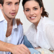 Young couple playing chess — Stock Photo #8337525