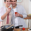 Couple cooking together and drinking wine — Stock Photo