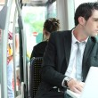 Businessman on the bus — Stock Photo #8337657