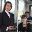 Stock Photo: Female ticket inspector on tram