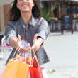 Dark-haired lady with shopping bags - Stock Photo
