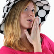 Stock Photo: Womin polkdot floppy hat