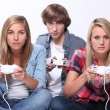 Stock Photo: Teenagers playing video games