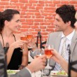 Stock Photo: Romantic foursome at restaurant