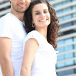 Couple stood in front of office block — Stock Photo #8339342