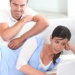 Couple sat in living-room — Stock Photo #8339377