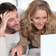 Couple on laptop. - Stock Photo