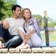 Couple on pontoon - Stock Photo