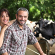 Happy couple working in their farm — Stock Photo