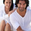 Studio portrait of a relaxed couple on white - Stock Photo