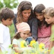 Children having a nature class in the park — Stock Photo