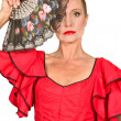 Woman in flamenco dress with fan — Stock Photo