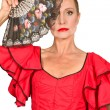 Stock Photo: Woman in flamenco dress with fan