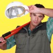 Stock Photo: Construction worker wiping his brow