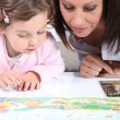 Mother and child looking at a book — Stock Photo #8339947