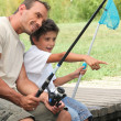Foto Stock: Father and son fishing