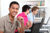 Afro-American student working on his laptop — Stock Photo