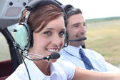 Female pilot of a light aircraft — Stock Photo
