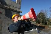 Man shouting through traffic cone — Stock Photo