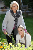Mother and daughter gardening — Stock Photo