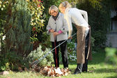 Elderly woman with her gardener — Stock Photo