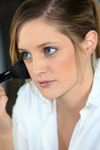 Cute blonde in her prime with blush brush — Stock Photo