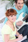 Couple writing song — Stock Photo