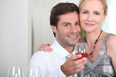 Couple drinking rose wine — Stock Photo