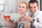 Couple with rose wine at a dinner party — Stock Photo