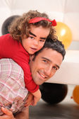Little girl on daddy's back celebrating Halloween — Stock Photo