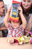 Little boy opening birthday present — Stok fotoğraf