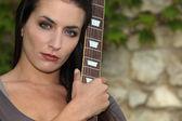 Beautiful brunette with bass — Stock Photo