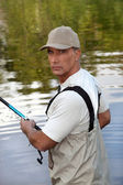 Fisherman fishing — Stock Photo