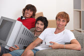 Three young men moving into to new house — Stock Photo