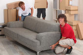 Men moving into new house — Stock Photo