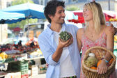 Elegant couple doing their market — Stock Photo