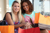 Friends out shopping together — Stock Photo