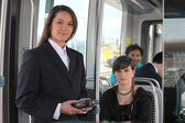 Female ticket inspector on a tram — Stock Photo