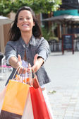 Dark-haired lady with shopping bags — Stock Photo