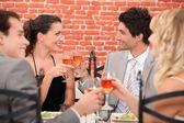 Romantic foursome at restaurant — Stock Photo