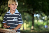 Little boy playing bongo in park — Stock Photo