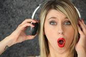 Woman listening to loud music — Stock Photo
