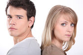 Man and woman back to back — Stock Photo