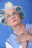 Elderly woman with her hair in rollers — Stock Photo