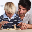Father and son playing domino - Stock Photo